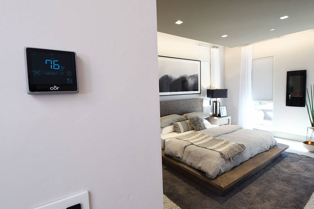 The Darwin circadian lighting system couples programmable LEDs with motorized window shades. (KB Home)
