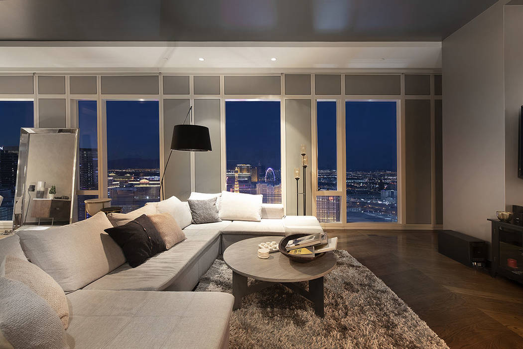 The living room in unit 4504 in Waldorf Astoria, which sold for $4.6 million, has a view of the High Roller Observation Wheel. (Acclaim)