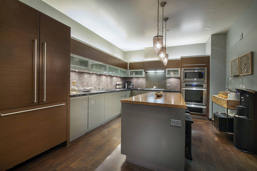 The kitchen in unit 4504 in Waldorf Astoria is modern. (Acclaim)