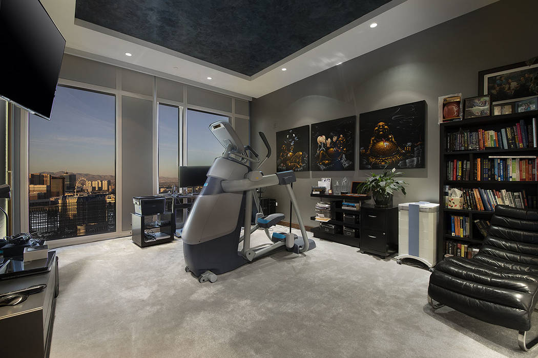 The gym in unit 4504 in Waldorf Astoria has a view of the Strip. (Acclaim)