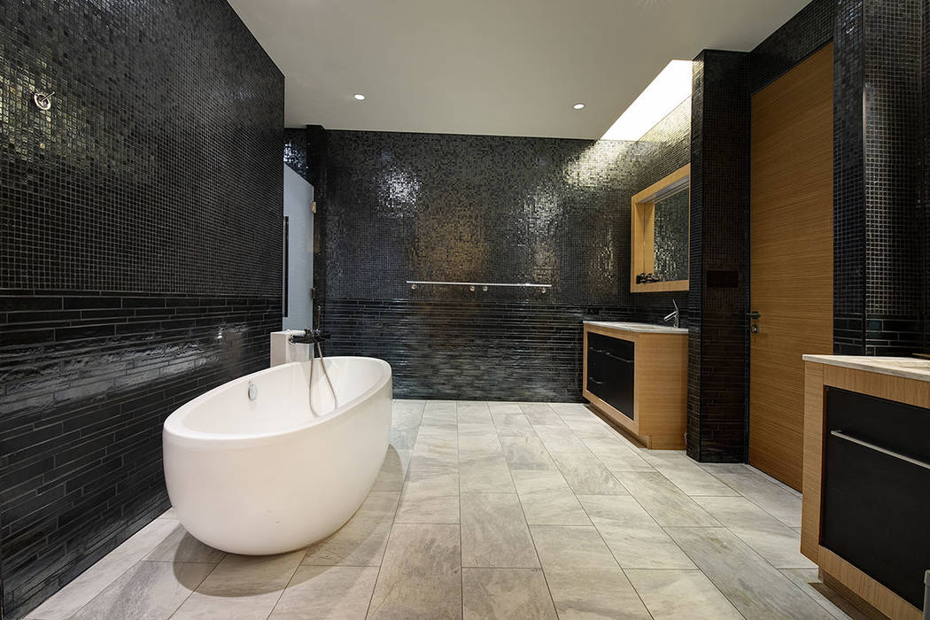 The master bath in unit 4504 in Waldorf Astoria. (Acclaim)