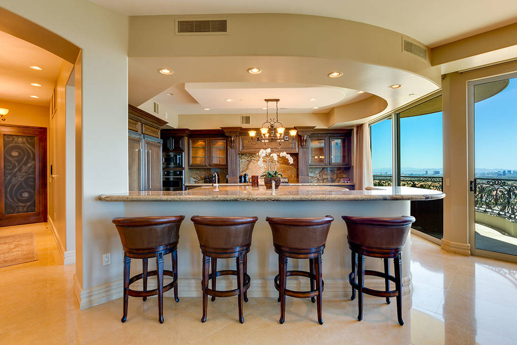 The central bar in unit 1603 in One Queensridge Place. (Ivan Sher Group)