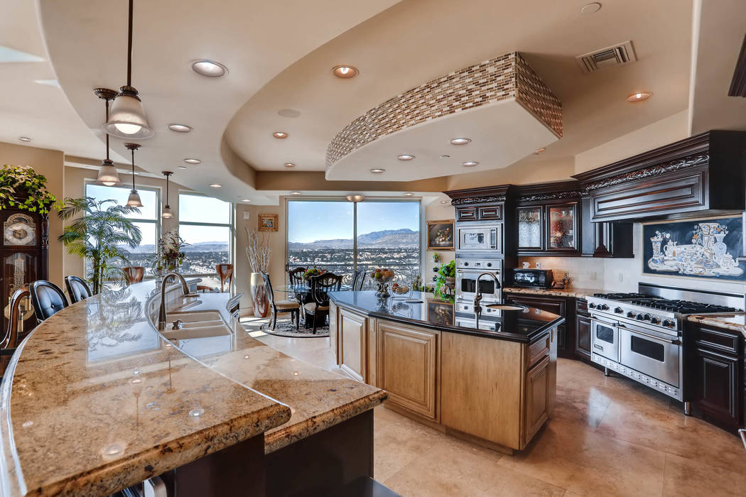 The kitchen in unit 1501 in One Queensridge Place is large. (Char Luxury Real Estate)
