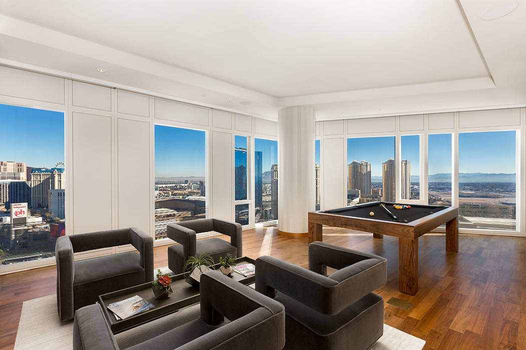 The living room in Waldorf Astoria unit No. 2403 has lots of windows for Strip views. (Luxury Estates International)
