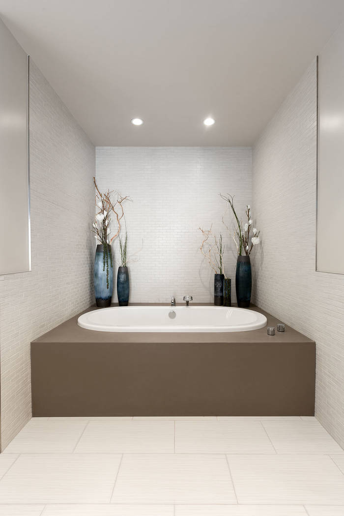 The master bath in Waldorf Astoria unit No. 2403 has a large tub. (Luxury Estates International)