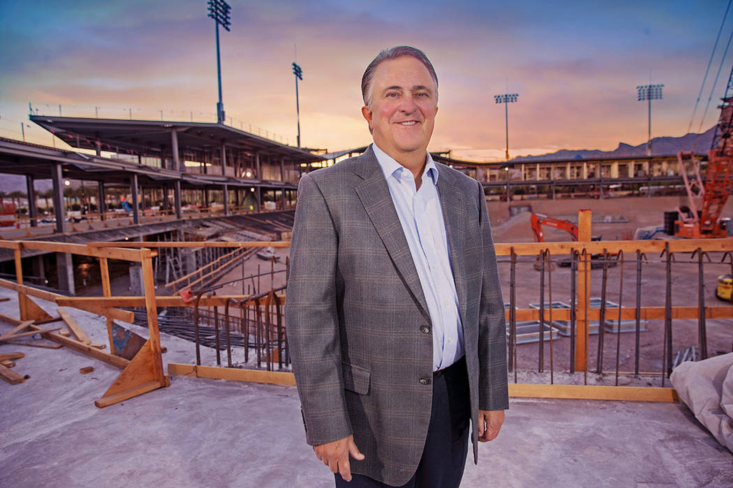 Don Logan, president and chief operating officer of the Las Vegas Aviators, and wife, Jen, are longtime residents of Summerlin. He stands near the construction site of the Las Vegas Ballpark. (Sum ...
