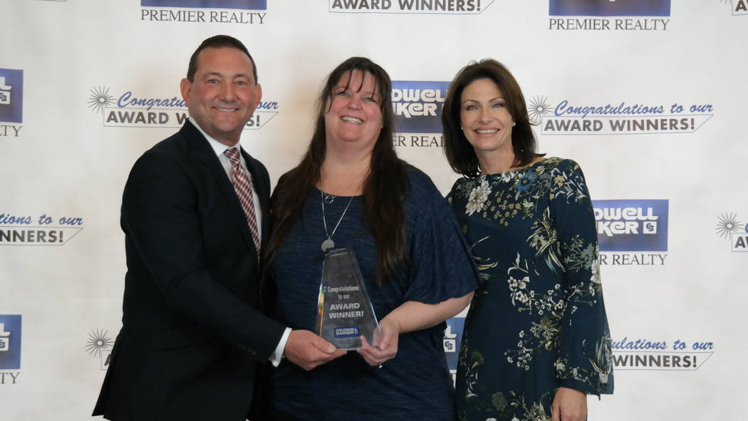 Bob and Molly Hamrick, left, poses with Audra Damore, who won a Outgoing Referral Excellence award. (Elaina Hunley/Coldwell Banker Premier Realty)