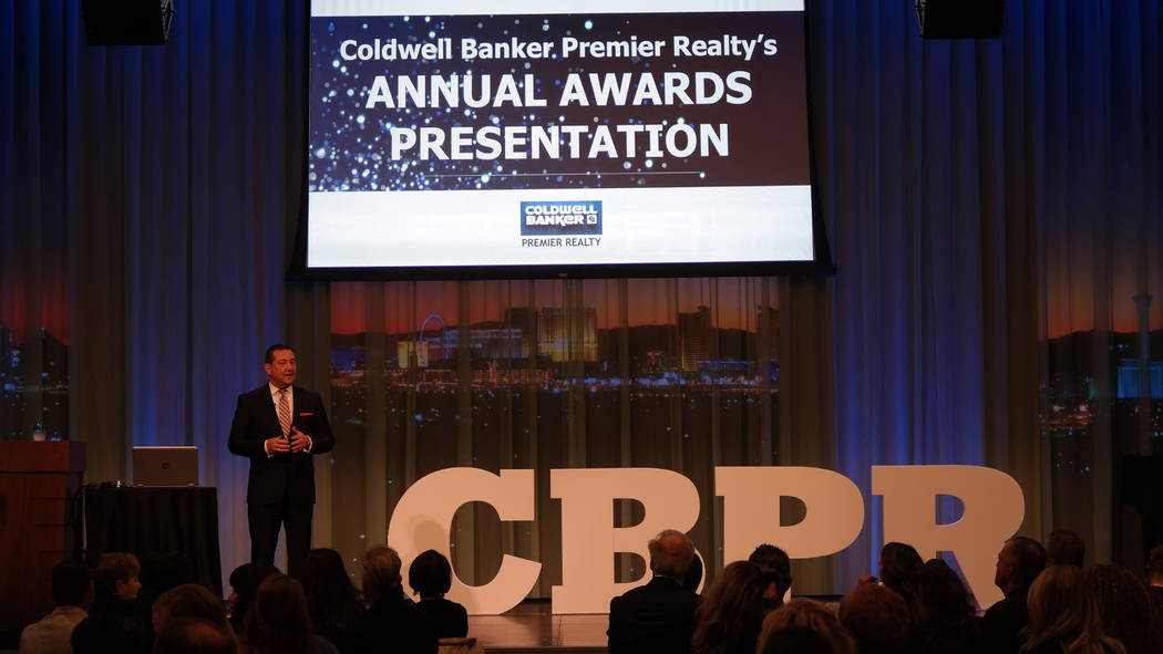 Coldwell Banker Premier Realty Chairman and CEO Bob Hamrick addresses his company Feb. 20 at an awards ceremony at the The Smith Center for Performing Arts. (Elaina Hunley/Coldwell Banker Premier ...