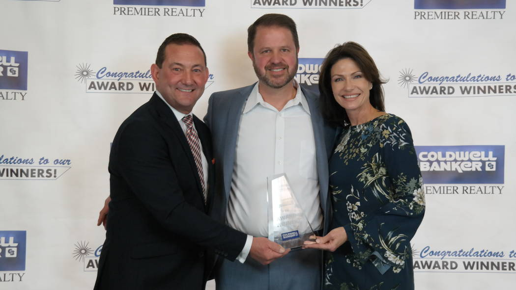 Bob and Molly Hamrick, left, poses with Brandon Bueltel, who was a Gross Commission Income Medalist. (Elaina Hunley/Coldwell Banker Premier Realty)
