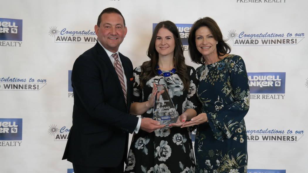 Bob and Molly Hamrick, left, poses with Brandon Bueltel, who won a Horizon Award. (Elaina Hunley/Coldwell Banker Premier Realty)
