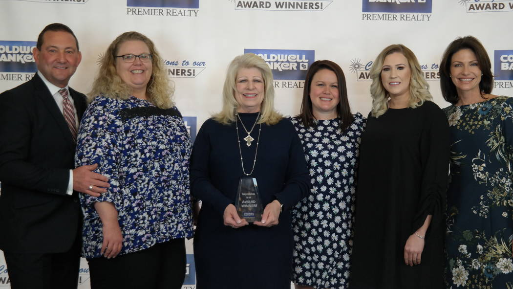 Bob and Molly Hamrick with the Coldwell Banker Premier Realty's Corporate Services Department, which won Cartus awards. (Elaina Hunley/Coldwell Banker Premier Realty)