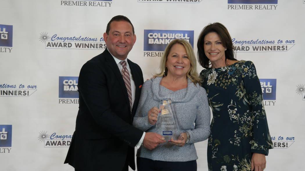 Bob and Molly Hamrick, left, poses with Cheri Sacenti, who won a Diamond Society Award. (Elaina Hunley/Coldwell Banker Premier Realty)