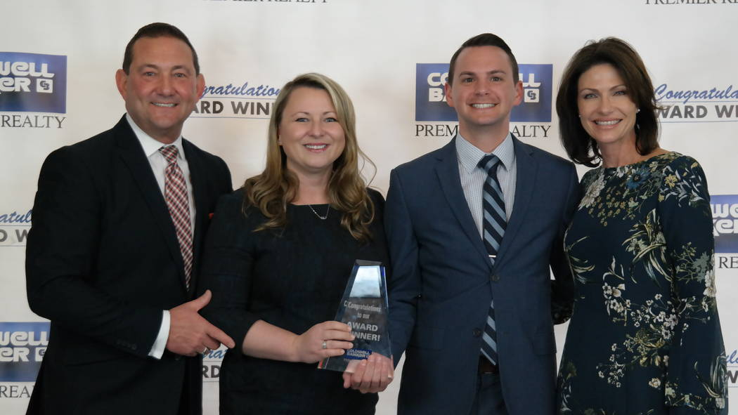 Bob and Molly Hamrick with the Cooper Kattau Team, which was a Gross Commission Income Medalist. (Elaina Hunley/Coldwell Banker Premier Realty)