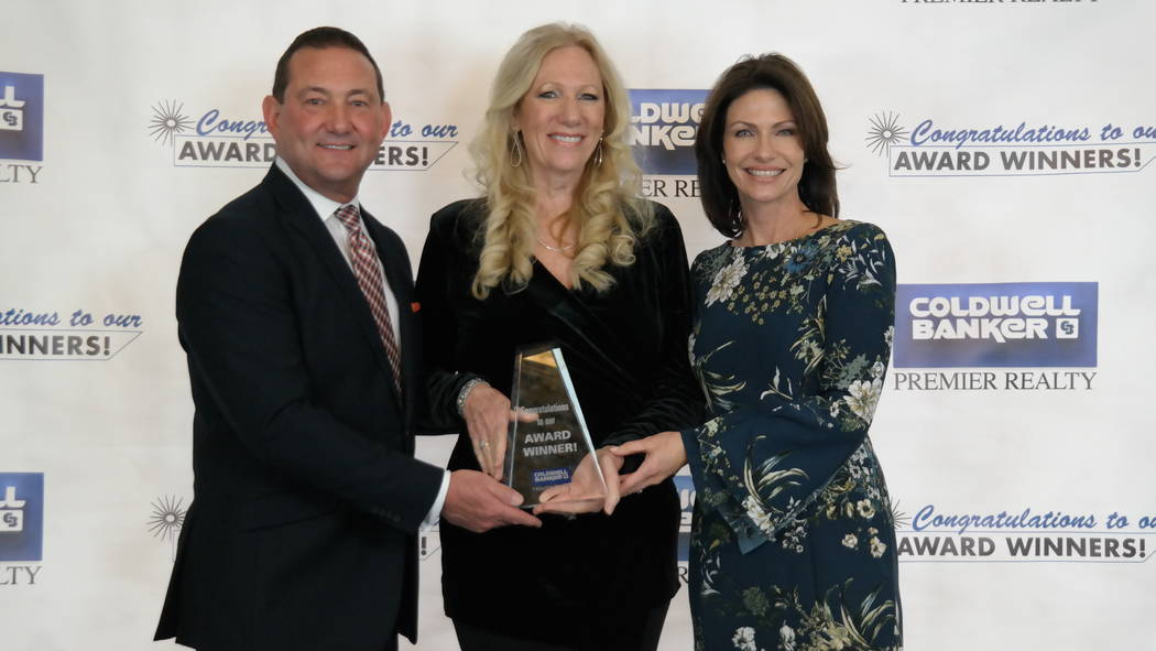 Realtor Diane Varney won the Associate Vice President Award and was a Bronze Gross Commission Income Medalist. Bob and Molly Hamrick congratulate her. (Elaina Hunley/Coldwell Banker Premier Realty)