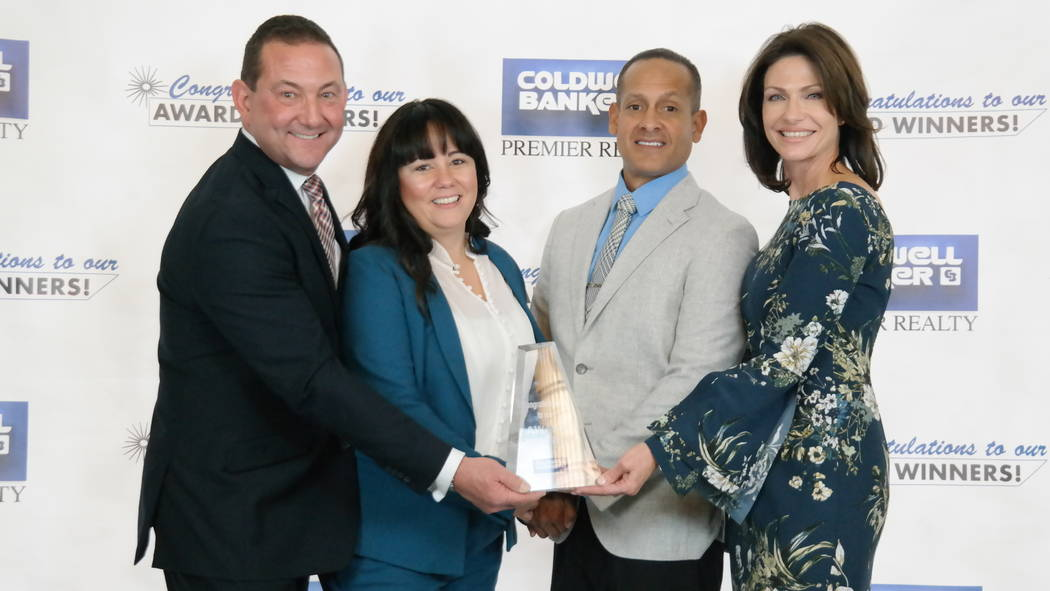 Bob and Molly Hamrick with the Gaitan Group, which won five awards. (Elaina Hunley/Coldwell Banker Premier Realty)