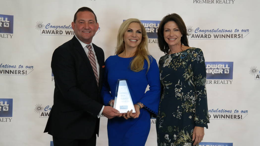 Ginger Campbell with Bob and Molly Hamrick. Campbell won four awards. (Elaina Hunley/Coldwell Banker Premier Realty)