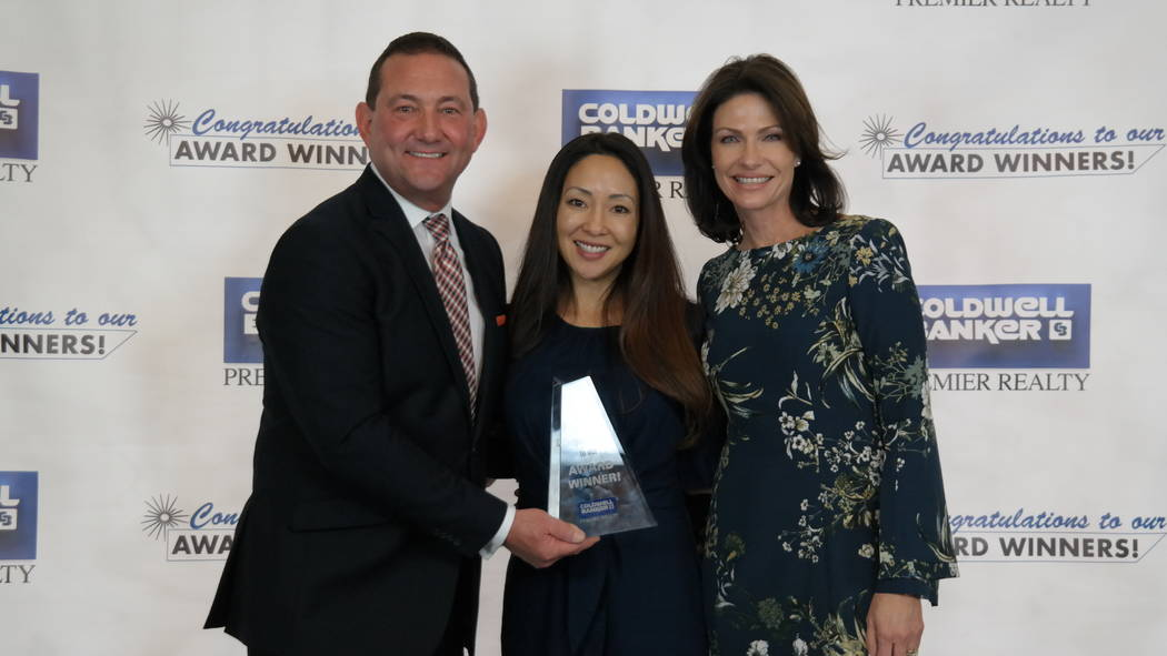 Jessie Sorani won three awards. Here, she is with Bob and Molly Hamrick. (Elaina Hunley/Coldwell Banker Premier Realty)