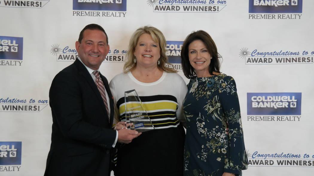 Bob and Molly Hamrick with Jill Alegre, who won a Sterling Society Award. (Elaina Hunley/Coldwell Banker Premier Realty)