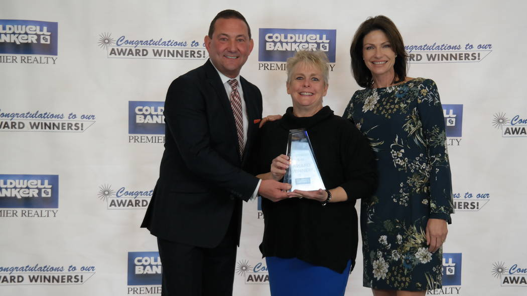 Jill Tyra won four awards. She poses for a photo with Bob and Molly Hamrick. (Elaina Hunley/Coldwell Banker Premier Realty)