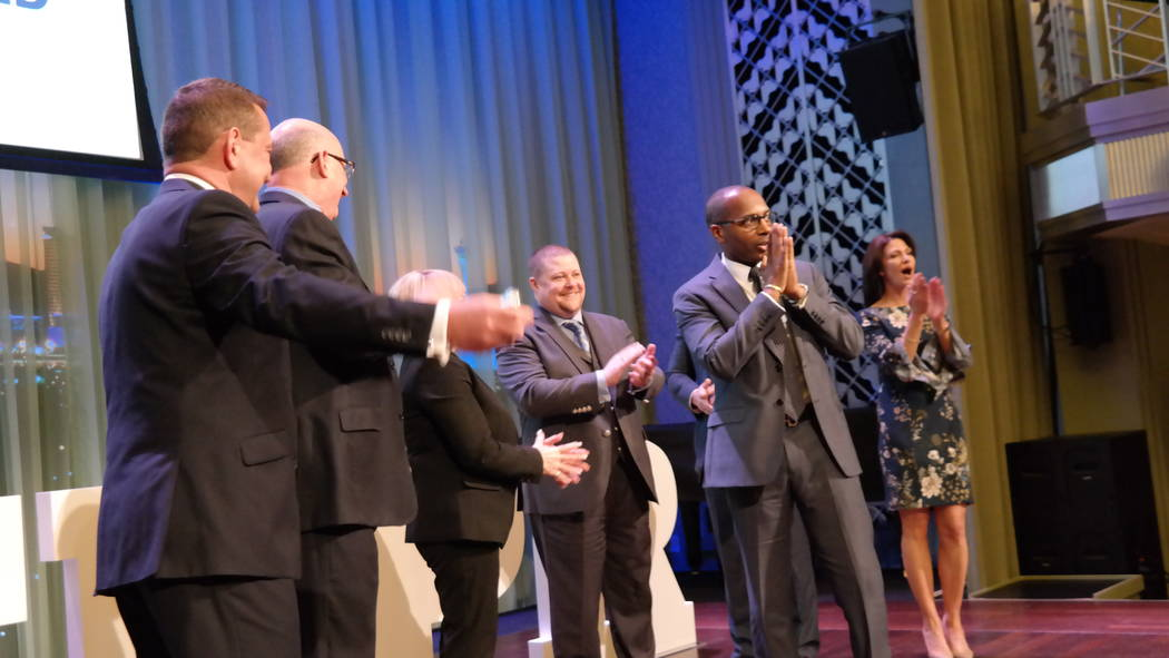 Lavert Benefield walks on stage to receive the Marilyn Squitieri Award. (Elaina Hunley/Coldwell Banker Premier Realty)