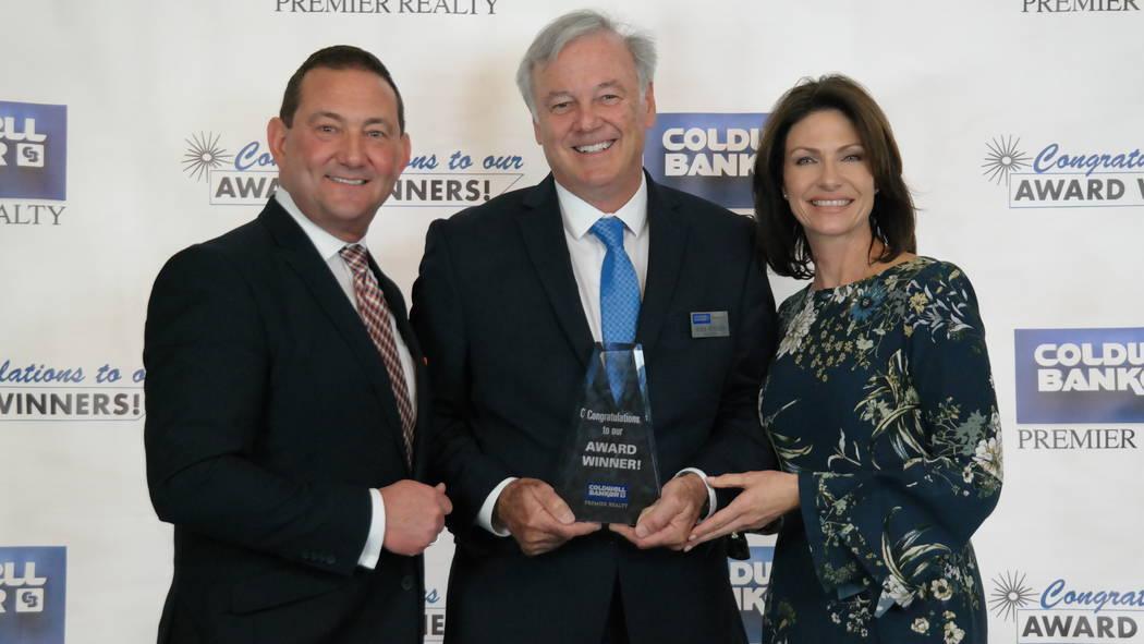 Mark Peveler with Bob and Molly Hamrick. Peveler won the Diamond Society and Skyrocket awards. (Elaina Hunley/Coldwell Banker Premier Realty)