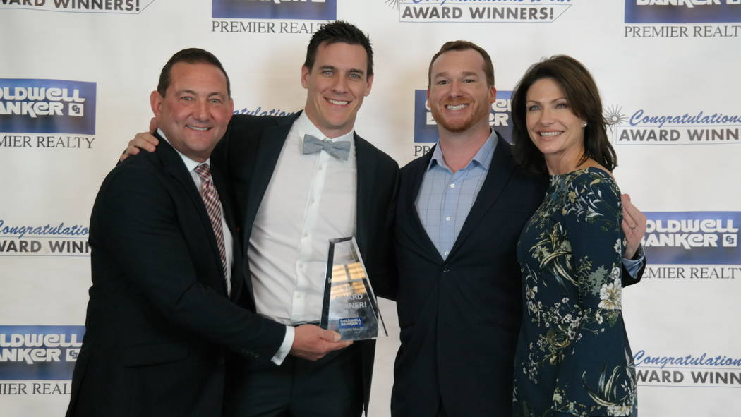 The Mike McNamara Group won several awards. Here, they are with Bob and Molly Hamrick. (Elaina Hunley/Coldwell Banker Premier Realty)