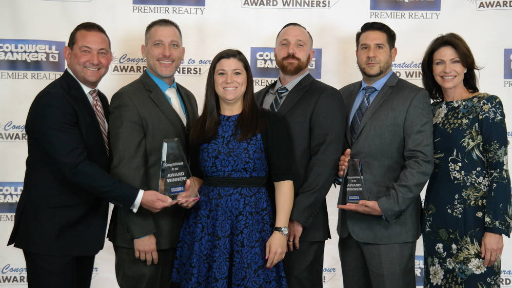 The Moretti Team won four awards. Here, they are with Bob and Molly Hamrick. (Elaina Hunley/Coldwell Banker Premier Realty)