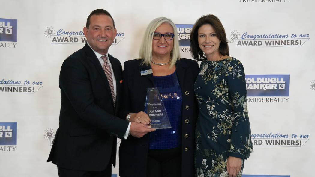 Nancy Call won the Skyrocket Award. Here, she is with Bob and Molly Hamrick. (Elaina Hunley/Coldwell Banker Premier Realty)