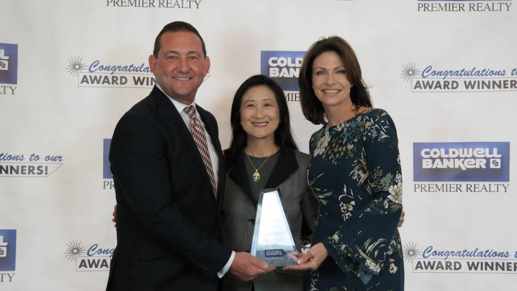 Nancy Wong with Bob and Molly Hamrick. Wong won the Sterling Society Award. (Elaina Hunley/Coldwell Banker Premier Realty)