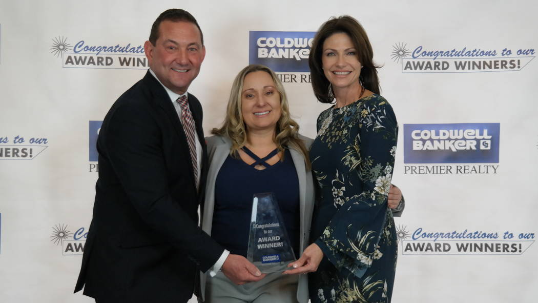 Nichole LaVigne won two awards. Here, she is with Bob and Molly Hamrick. (Elaina Hunley/Coldwell Banker Premier Realty)