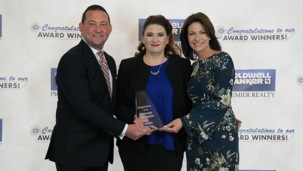 Paula Burlison with Bob and Molly Hamrick. Burlison won five awards. (Elaina Hunley/Coldwell Banker Premier Realty)