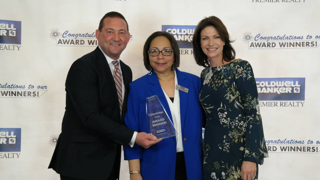 Regana Kooman-Henry won five awards. Here, she is with Bob and Molly Hamrick. (Elaina Hunley/Coldwell Banker Premier Realty)