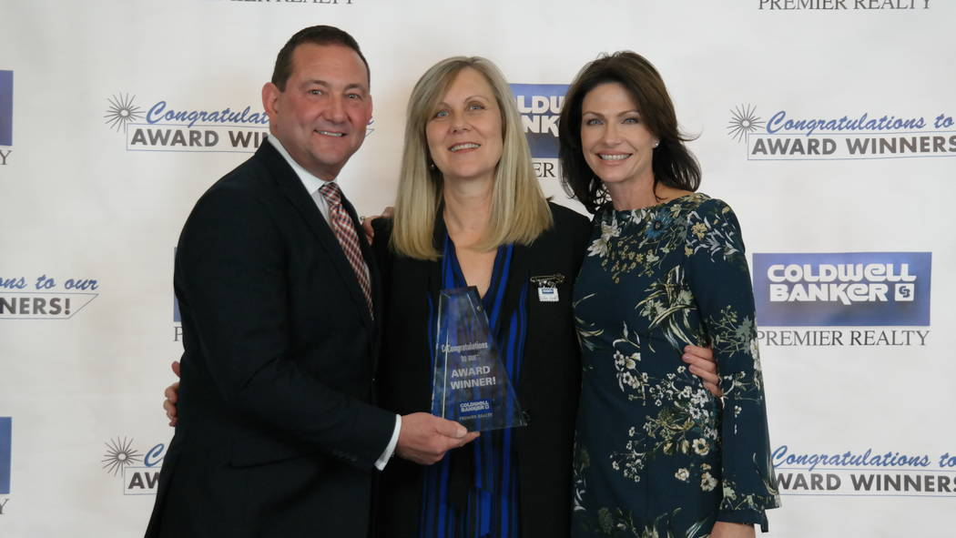 Robin Riedel won four awards. Here, she is with Bob and Molly Hamrick. (Elaina Hunley/Coldwell Banker Premier Realty)