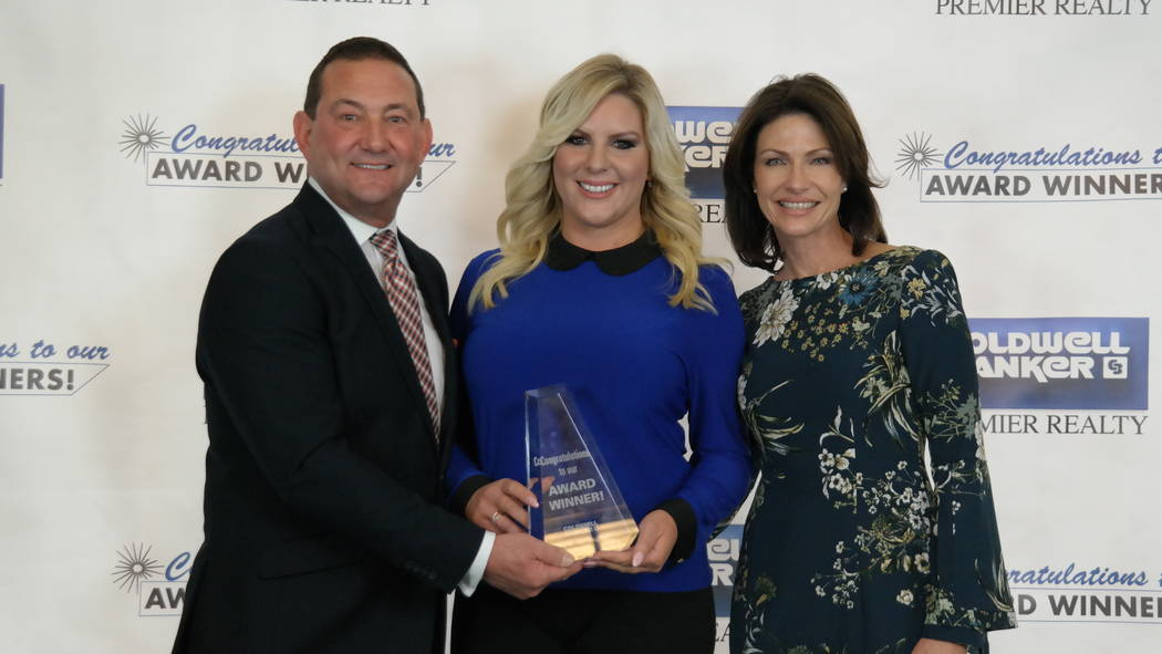 Sarah Cadiz won Rookie of the Year. Here, she is with Bob and Molly Hamrick. (Elaina Hunley/Coldwell Banker Premier Realty)