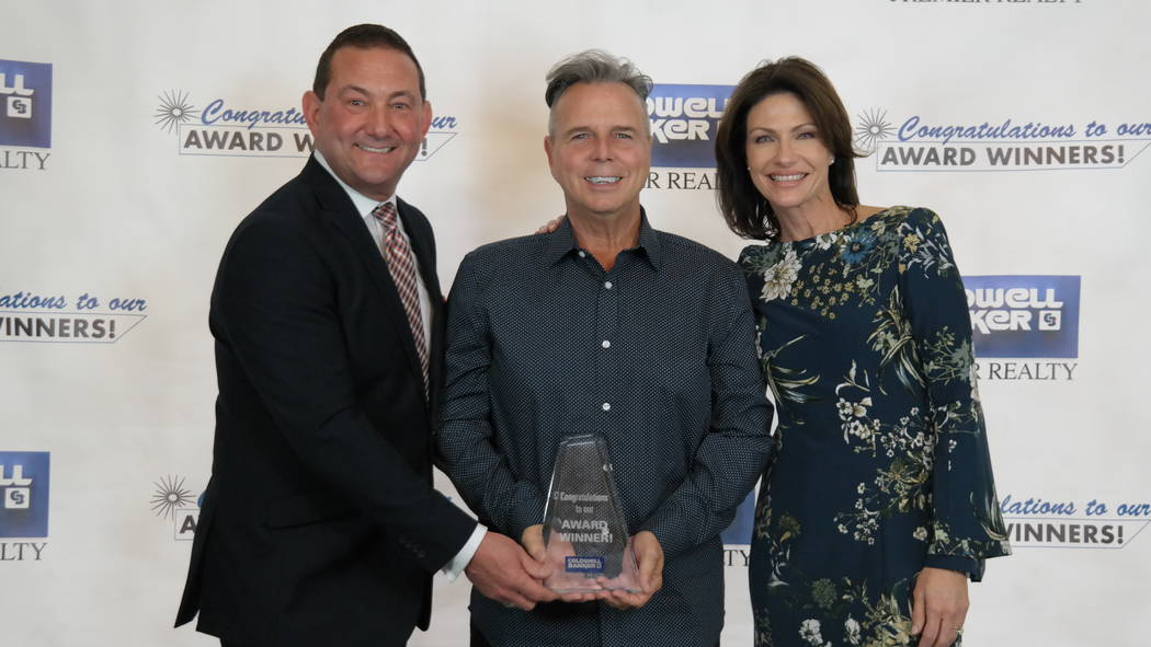 Stan Hicks won three awards. Here, he is with Bob and Molly Hamrick. (Elaina Hunley/Coldwell Banker Premier Realty)