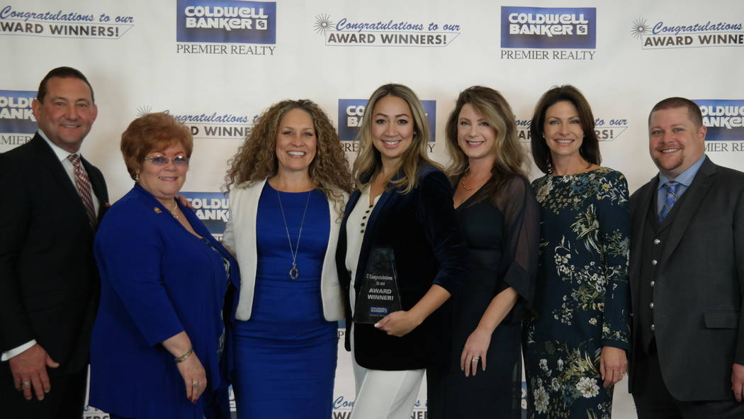 The Hutchins Team is joined by Bob and Molly Hamrick. The team won four awards. (Elaina Hunley/Coldwell Banker Premier Realty)