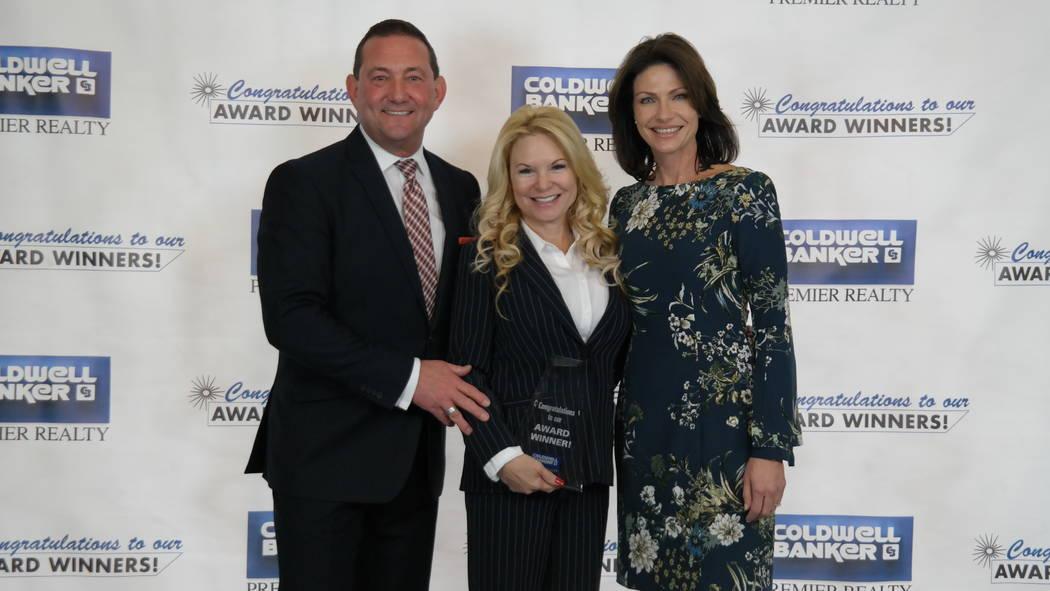 Tina Mello won six awards. Here, she is with Bob and Molly Hamrick. (Elaina Hunley/Coldwell Banker Premier Realty)