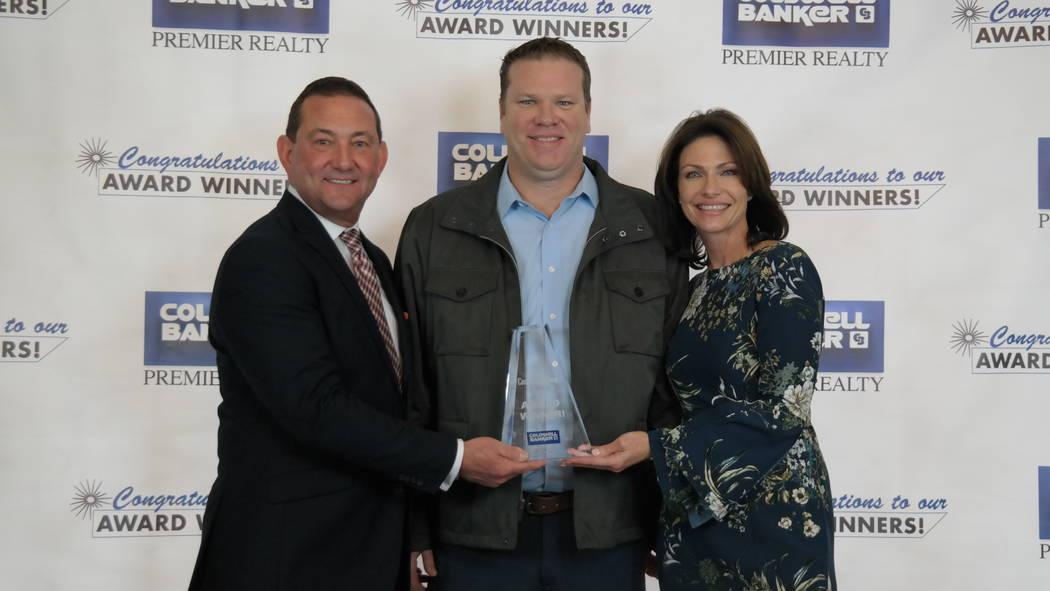 Todd Lemoine with Bob and Molly Hamrick. Lemoine won a Skyrocket Award. (Elaina Hunley/Coldwell Banker Premier Realty)