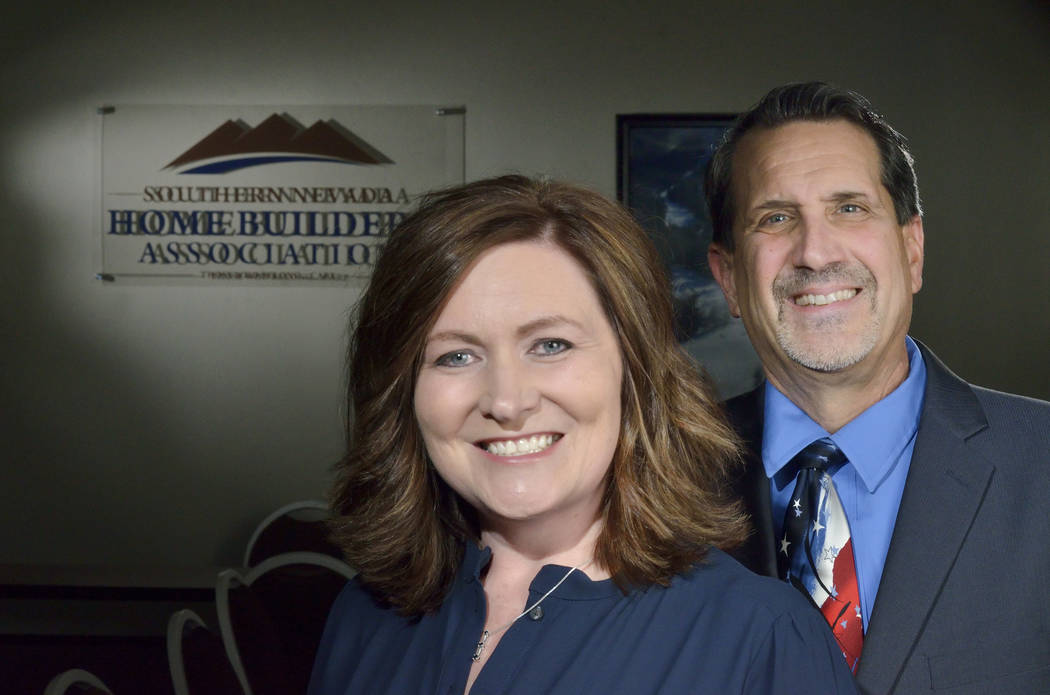 Janet Love, president of the Southern Nevada Homebuilders Association and of StoryBook Homes, and Nat Hodgson, CEO of SNHBA and executive director of HomeAid of Nevada, are shown at the SNHBA offi ...