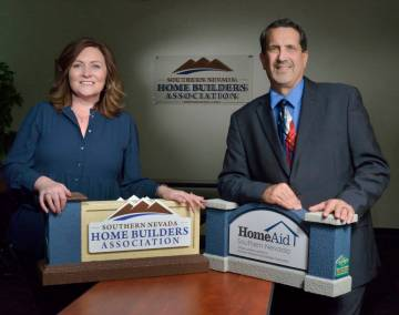 Janet Love, president of the Southern Nevada Homebuilders Association and of StoryBook Homes, and Nat Hodgson, CEO of SNHBA and executive director of HomeAid of Nevada. (Bill Hughes/RJRealEstate.V ...