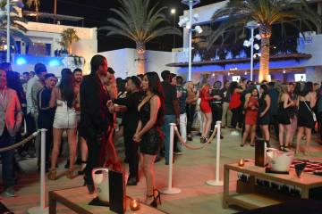 People line up for the grand opening weekend of Kaos, the new dayclub and nightclub at The Palm ...