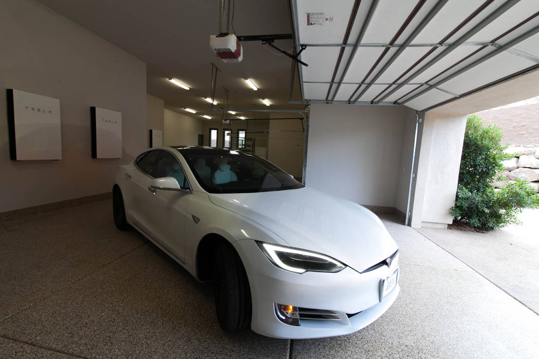 The six-car garage includes four integrated Tesla Powerwall 2 battery storage modules. (Growth ...