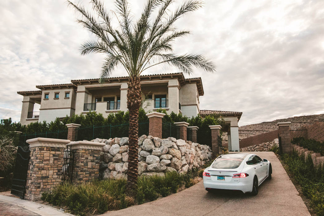 A Tesla comes with the home at 27 Shadow Canyon Court in Southern Highlands. (Growth Luxury Homes)