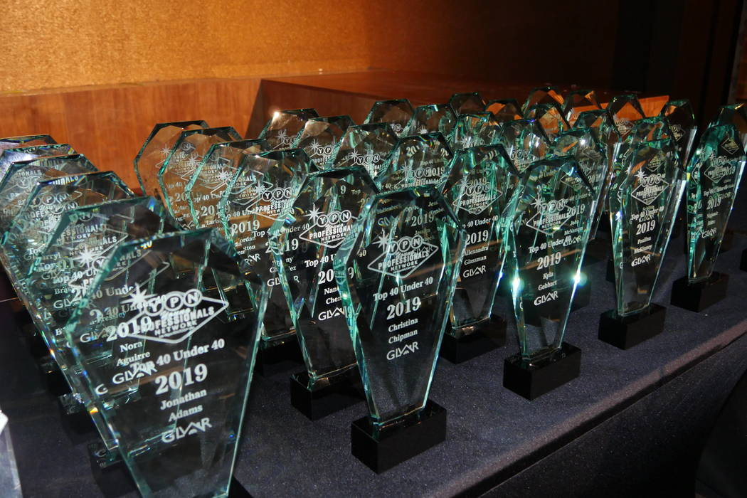 Trophies on display for the May 23 YPN Top 40 Under 40 event at the Vanity nightclub inside the ...