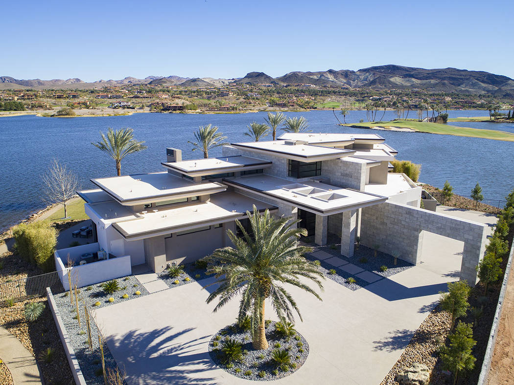 Sited on a 1.2-acre lot, the two-story, 8,838-square-foot desert-contemporary home is listed fo ...