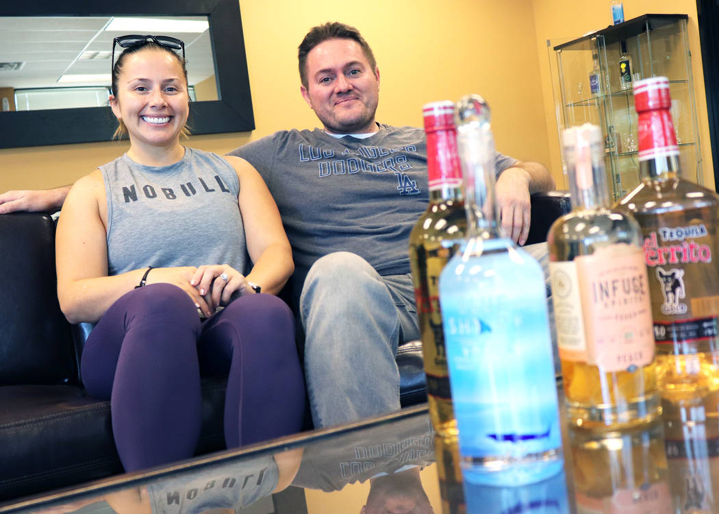 Brother and sister, Jose and Liliana Gonzales manage Las Vegas Tequila Bottling LLC, a family- ...