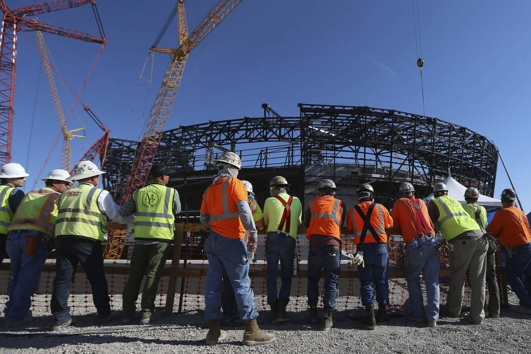 In this Aug. 5 photo, workers attend the Las Vegas Stadium Topping Out Ceremony in Las Vegas. ( ...