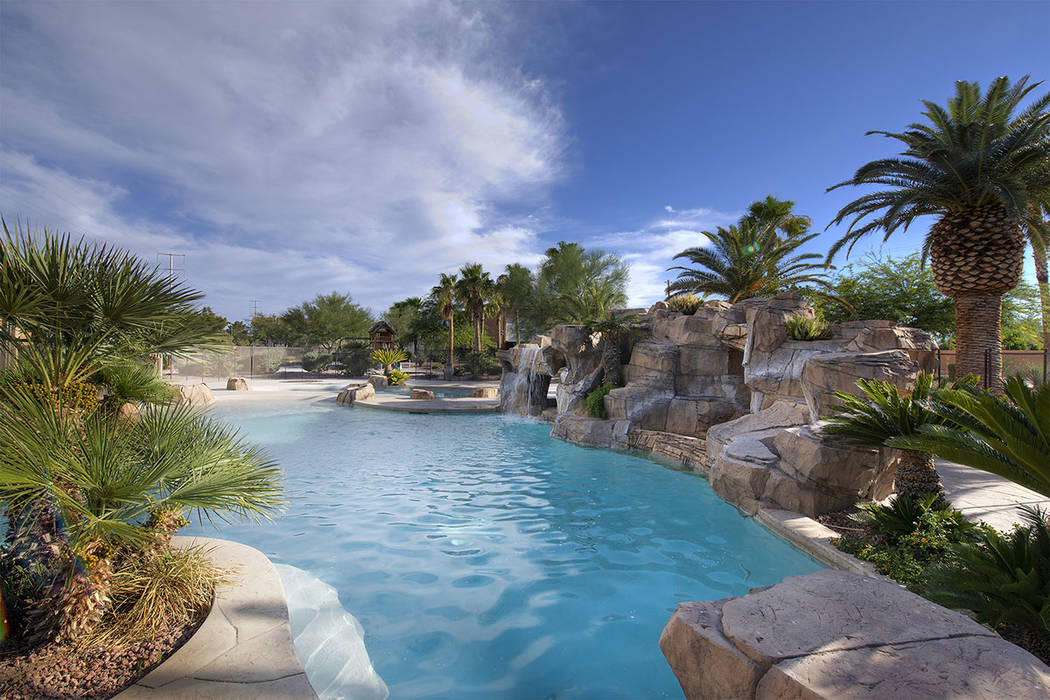 The pool has waterfalls. (Synergy|Sotheby's International Realty)