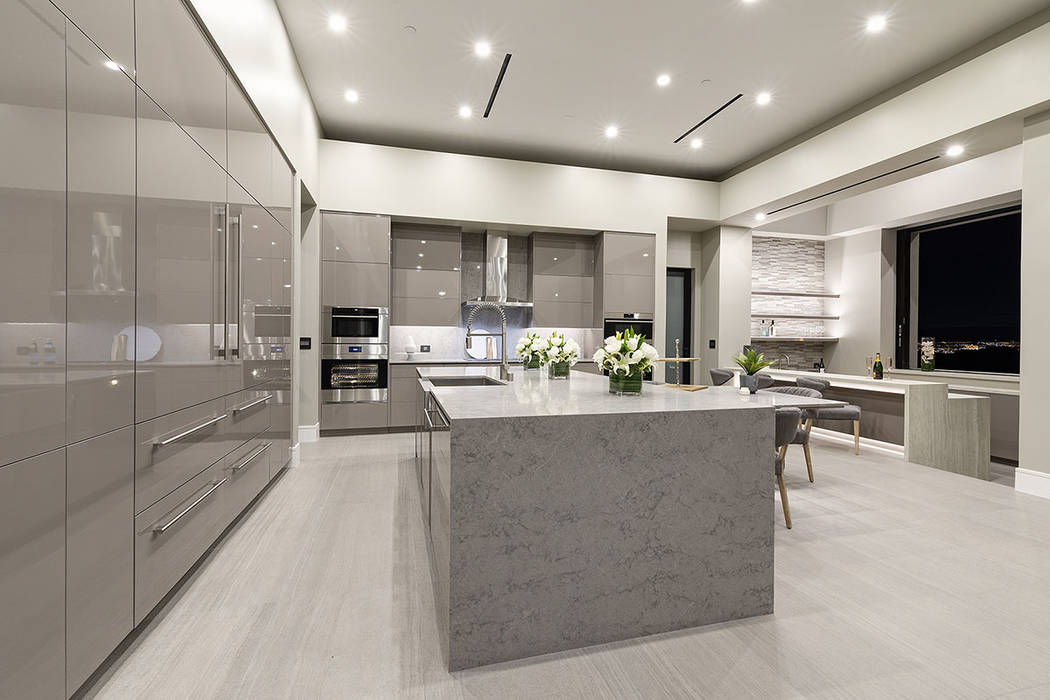 The kitchen has all the latest appliances. (Synergy|Sotheby's International Realty)