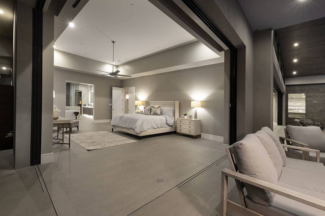 The master bedroom's corner wall opens to a balcony. (Synergy|Sotheby's International Realty)